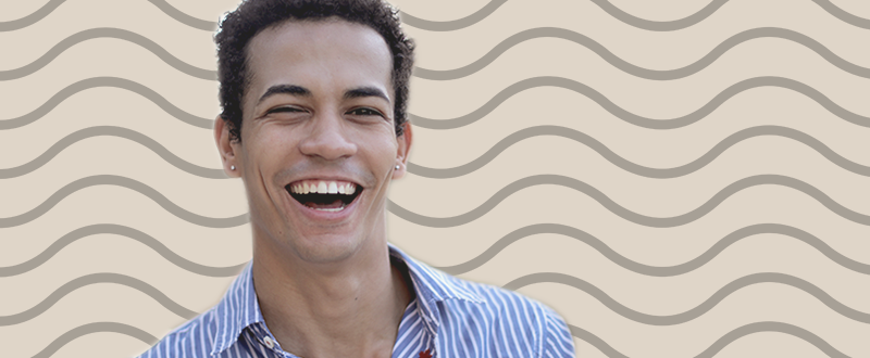 Young latin man laughing