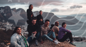 Diverse group of people on a mountain top